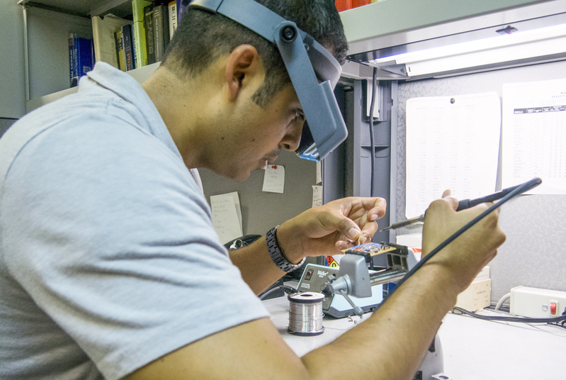 UC Mercec student working with laser at Castle