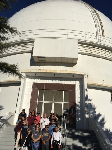 "group in front of 120"" telescope dome"